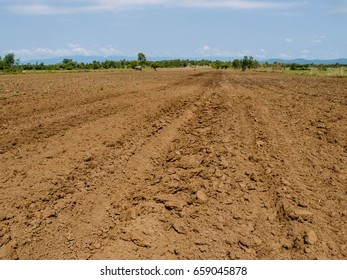 Brown soil plowed soil of an agricultural field