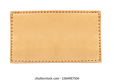 Brown stitched leather seam frame label tag isolated on white. Empty copy space fashion background.