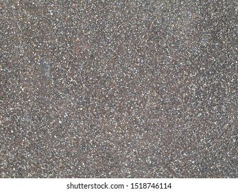 Brown stone grit scree for background. Brown gravel stone texture, granite gravel, rocks crushed for ground construction.