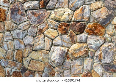 Brown stone wall texture and background