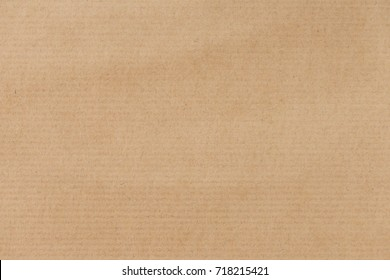 Brown striped recycle paper texture for wrapping. Kraft paper