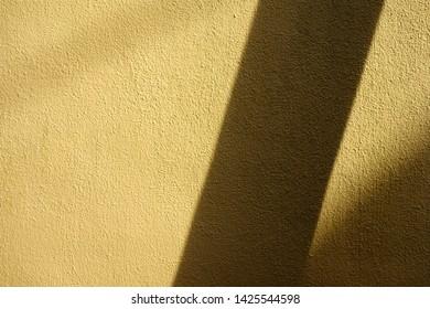 Brown stucco wall and shadow