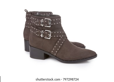 Brown studded ankle boots, isolated on white with shadow