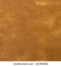 Brown suede closeup background.