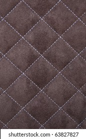 Brown suede leather with white criss cross stitching pattern