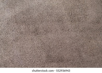 Brown suede soft leather as texture background. Close up shammy leather texture