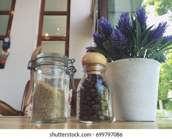 Brown sugar with coffee beans on wooden table in coffee cafe. (Vintage color tone)