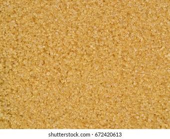 Brown sugar crystals  background texture.