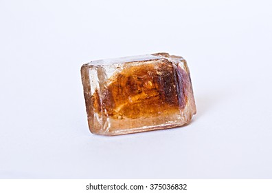 Brown sugar cube on the white background