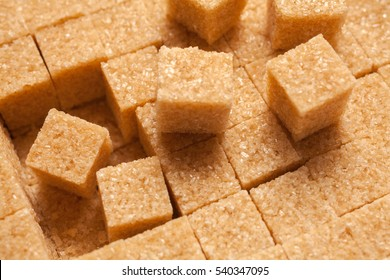 Brown sugar cubes. Food background