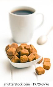 brown sugar cubes on white wooden table