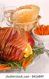 Brown sugar and honey glazed Easter ham with fruit and carrots