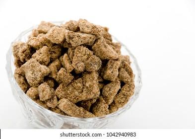 brown sugar lump in glass bowl