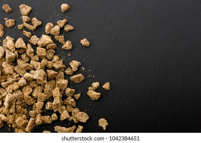 brown sugar lump on stone plate