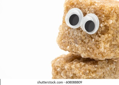 brown sugar monster with googly eyes on white background