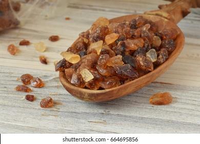 Brown sugar in old wooden spoon