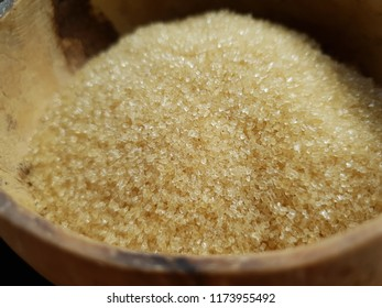 Brown sugar on bowl made form wood