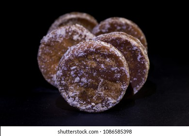 Brown sugar and palm sugar isolate on black background