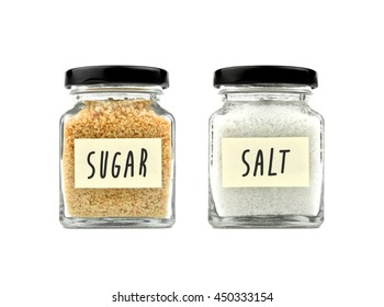 Brown sugar and salt in a glass jar with black lid and yellow sticky note paper isolated on white background, front view.