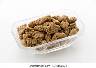 brown sugar in small square glass bowl