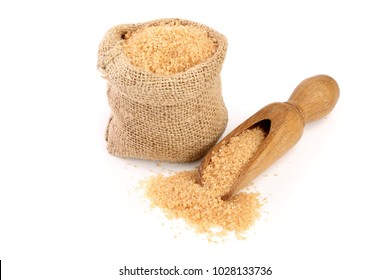 brown sugar in wooden scoop and bag isolated on white background