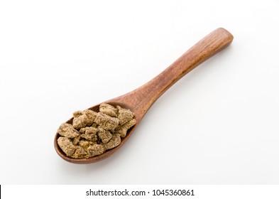 brown sugar in wooden spoon