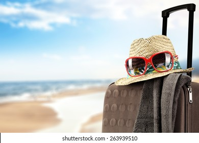 brown suitcase of summer time