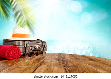 Brown summer suitcase and beach landscape with sea and coconut palm