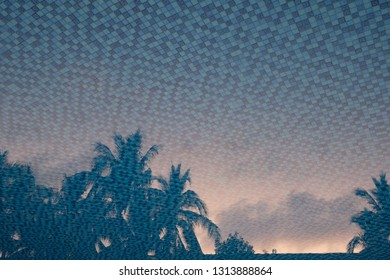 brown sunrise daybreak cloud sky and coconut palm trees reflection in water of blue mosaic tile pattern swimming pool. creative tropical travel holiday concept