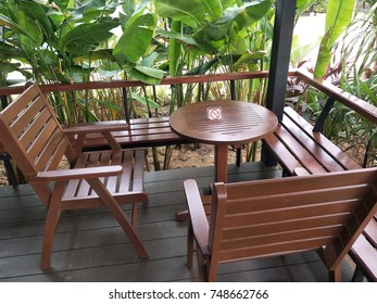 Brown table and brown chairs, front porch