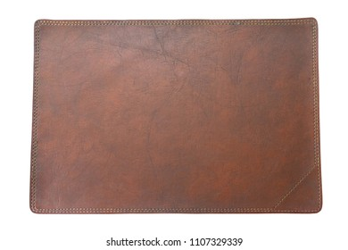 brown table mat made from leather isolated on white background with clipping path for selection