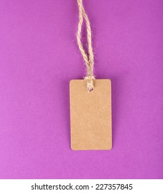 Brown tag on colorful background