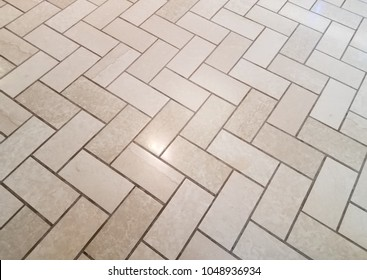 brown or tan floor tiles