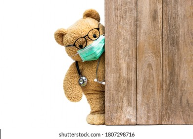 Brown teddy bear doctor with protective medical facemask and stethoscope. Quarantine coronavirus pandemic protection,  covid concept.