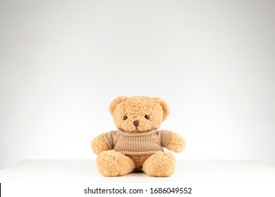 brown teddy bear isolated on white background,mock up for card cerebration