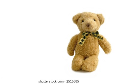 A brown teddy bear, isolated on white