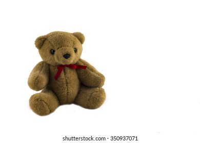 brown teddy bear on a white background
