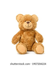 brown teddy bear sits on a white background, toy