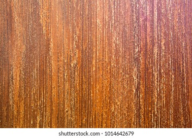 Brown texture in the relief of a vertical, shallow stripe. Interior design. Decorative coating for walls