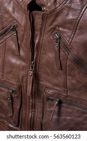 Brown textured leather jacket. Leather jacket macro details. Jacket zippers and pockets.