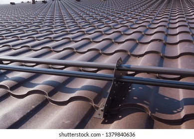 Brown tile roof of construction house with blue sky and cloud background. Natural photo.