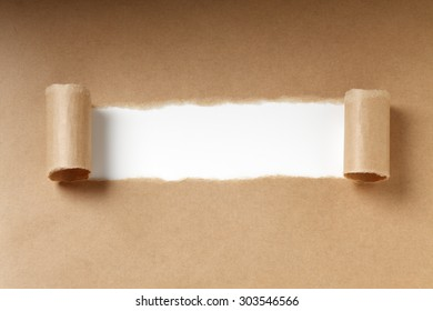 Brown torn paper on white
