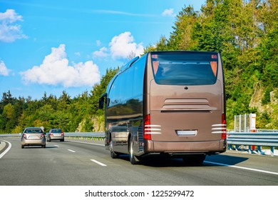 Brown Tourist bus on the road in Poland. Travel concept.