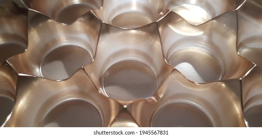 Brown translucent curly blank packaging for round chocolates (molded plastic tray) in the sun from the shade (animated photo, macro, texture).
