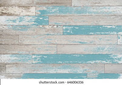 Brown, turquoise, and teal wood boards on a wall. Vintage wood background with colored stain or paint. Old horizontal board surface with old world feel.