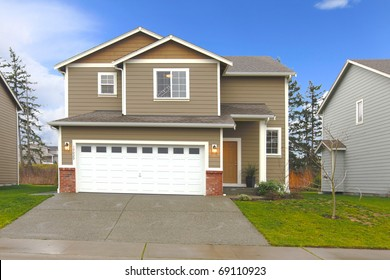 Brown  two level house with large garage door