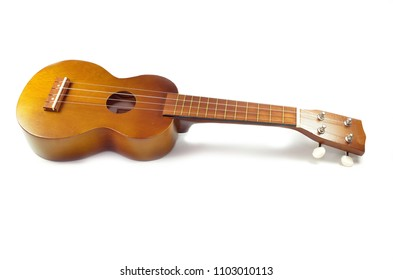Brown ukulele guitar isolated on the white background