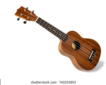 The brown ukulele on the white background