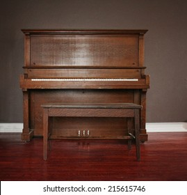brown upright piano in a living room