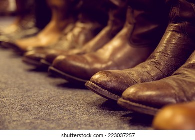 brown vintage leather boots aligned selective focus